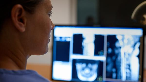 Physician reads radiology images
